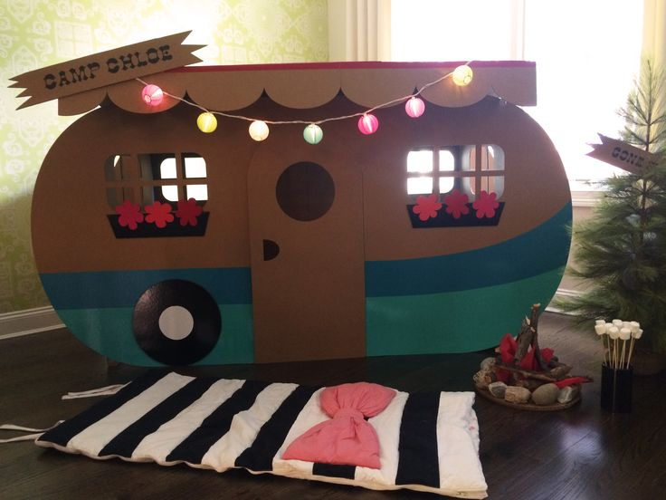 """It was a super fun experience! I started by setting designing and setting up the camper in the family room. The next items were a tree and camp fire made from rocks, branches, tissue paper and a flashlight. We also had some stars on the ceiling for our """"movie under the stars"""" - """"Curious George Goes Camping"""". As for activities the kids truly enjoyed playing in the camper but we also did a fish pond game and some craft activities (camper coloring sheets, coloring bird feeders and rock & twig…"""