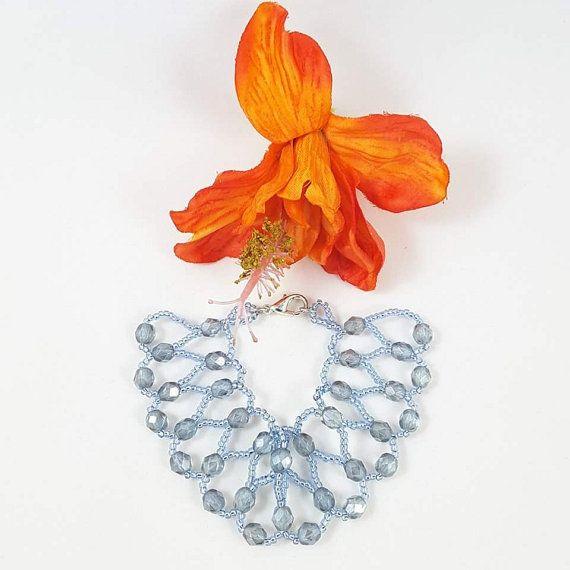 Bracciale perline azzurro grigio argento cristalli