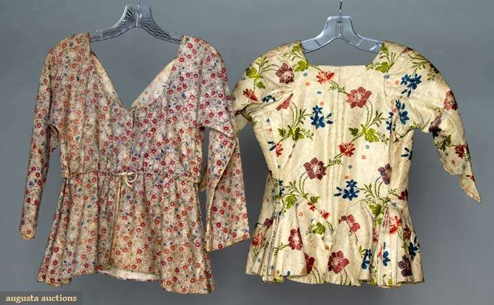 "PRINTED SHORT GOWN, c. 1800. Cream cotton block printed w/ small red, blue & tan flowers against brown stipled ground, draw-string neckline & draw cord empire waist, B 34"", L 21"", (3.5"" rip CB neckline) very good; t/w 1 c. 1765 bodice, ivory silk faille w/ jewel tone florals, attached peplum w/ accordion pleats at back sides, faux pockets, homespun linen & yellow tabby silk linings, CB boning, L 21"", (cuffs missing) very good. Brooklyn Museum"