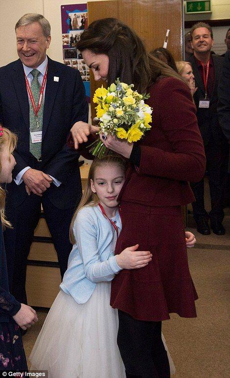 Ypapanti Galimatakis cuddles up to the Duchess...