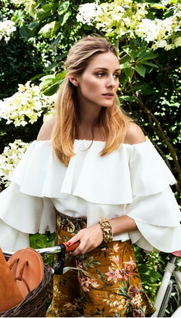 Who made  Olivia Palermo's handbag, brown floral shorts, jewelry, and off the shoulder white top?
