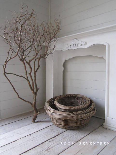 corner room ... white and brown contrast ... basketry ... tree limb ... fireplace mantel