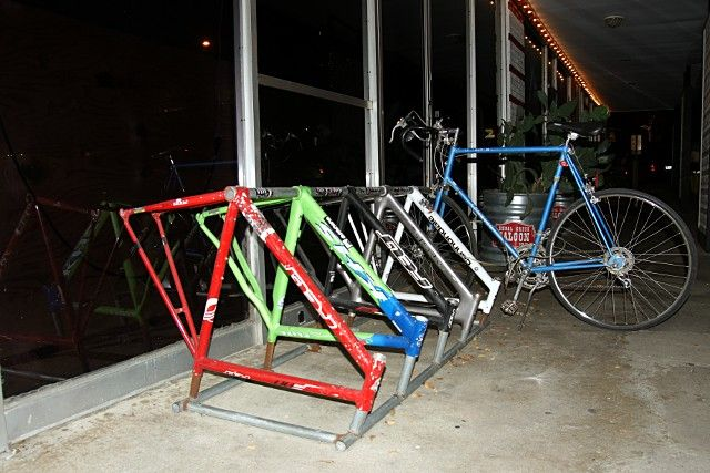 Bike frames repurposed as bike rack in Austin, TX. Click image for source, and visit the Slow Ottawa 'Nice Racks' board for more great designs.
