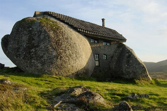 A House that Rocks  If you're looking for a rock-solid investment, how about this house in Portugal? Situated between two giant boulders, the house walls are formed of mortared masonry, and the living area is covered by concrete tile roofing. Fireproof, windproof, and impervious to insects.