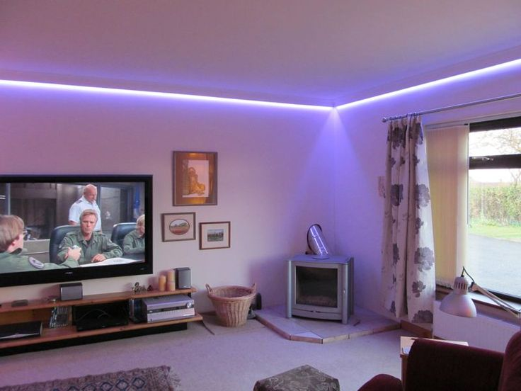 Concealed LED tape colour changing coving lighting.