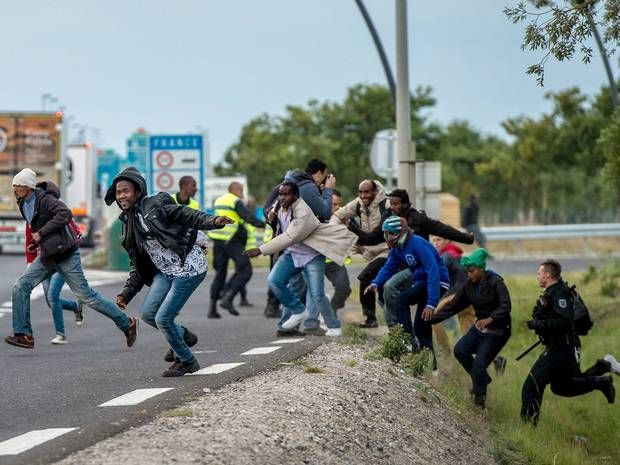 Calais crisis: Illegal migrants say they will continue to swarm the tunnel to get into the UK