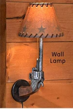 Gun wall lamp. I could make matching lamps with my husbands childhood guns.