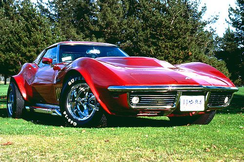 1968 Corvette Roadster in Candy Apple metal flake paint... THIS was mydream car, but I wanted it fitted with gullwing doors