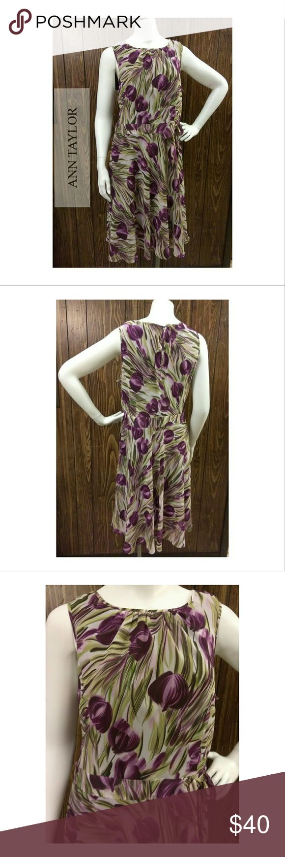 🍒Ann Taylor🍒 Petite Purple Tulip dress sz 12P Excellent pre-loved 💖 condition. Curved neckline, flare , slightly ruffled hem. Tie closure (pic 4). Flowy style, trendy graphic design, perfect for any occasion. Above knee length   Measurements are: Ann Taylor Dresses