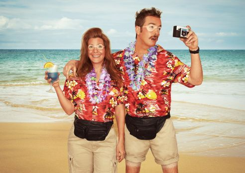Stock Photo : A sunburnt couple of tourists at the beach