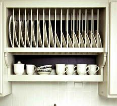 I really like these Plate Racks - and this one has plans at the site.  Designed to fit between existing cabinets or mounted by itself - it is very cute!  Would be so nice in a weekend/vacation cabin... some day...