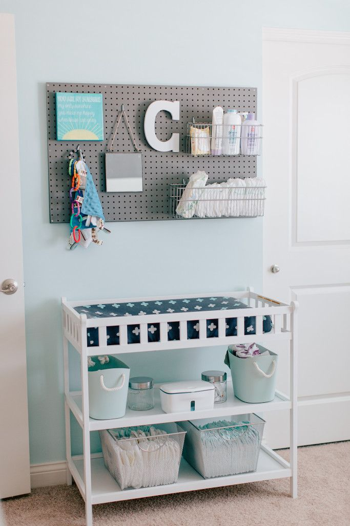 Pegboard above Changing Table for Storage - looks great and is functional! Love this nursery organization idea!