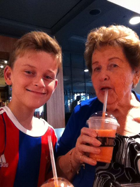 Me and my grandma having a healthy drink at the shops  # love top juice