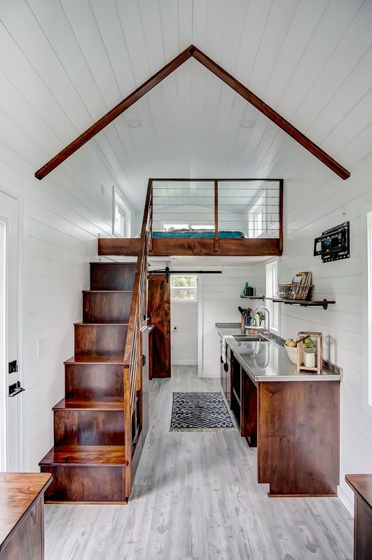 Inside The Tiny Home Are Poplar Walls And Vinyl Flooring For Easy Maintenance Stained Wood Finishes Add Vibrant Color Against White Light