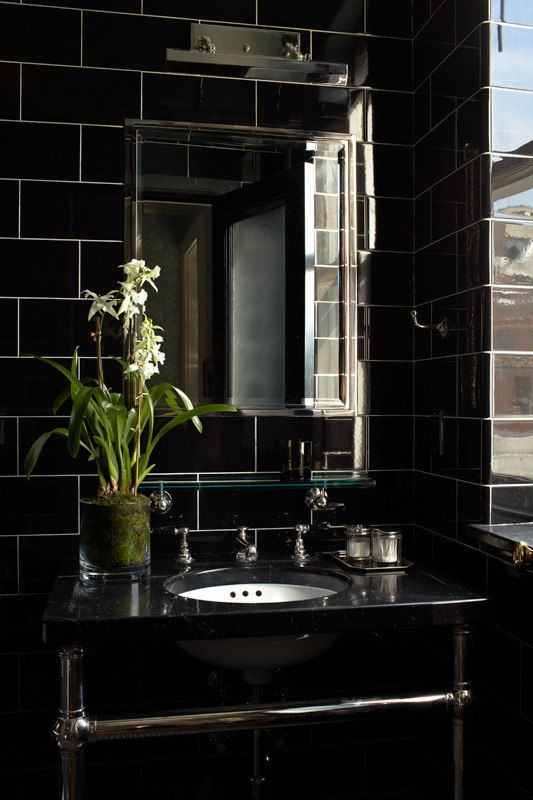 sooo moody... love.  the high polish of the tiles is key to reflect the natural light.  but my what a statement!