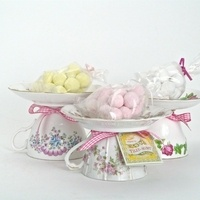Teacup favors.  You could set a candle on top of the saucer.
