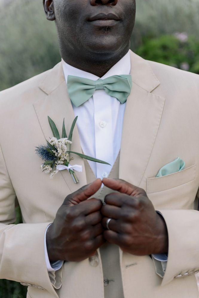 Tan suite with sage green accessories.
