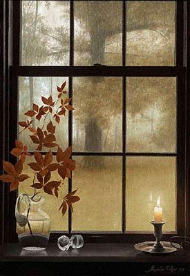 Mirando la lluvia tras la ventana