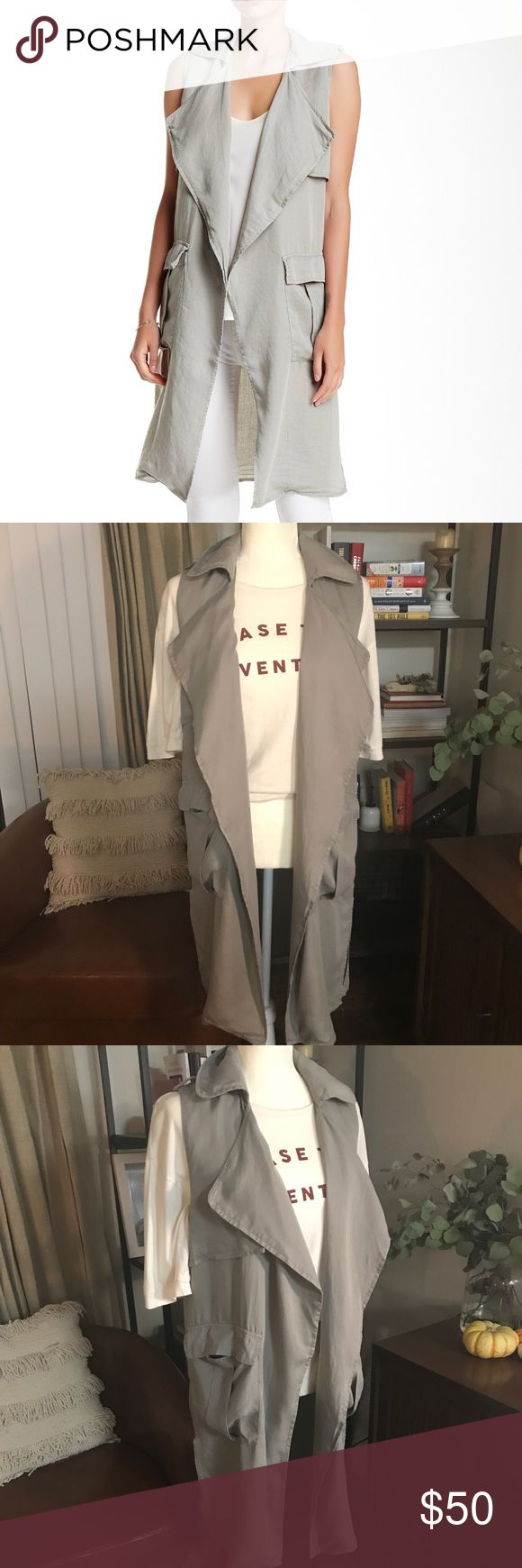 """NWT Walter Baker Terry Sleeveless Vest Sz M Walter Baker, oversized lapel flutters down the front of a safari inspired sleeveless cargo vest. Notch collar, sleeveless, open front, 2 front flap pockets, approx 38"""" length. 100% lyocell Walter Baker Jackets & Coats Vests"""