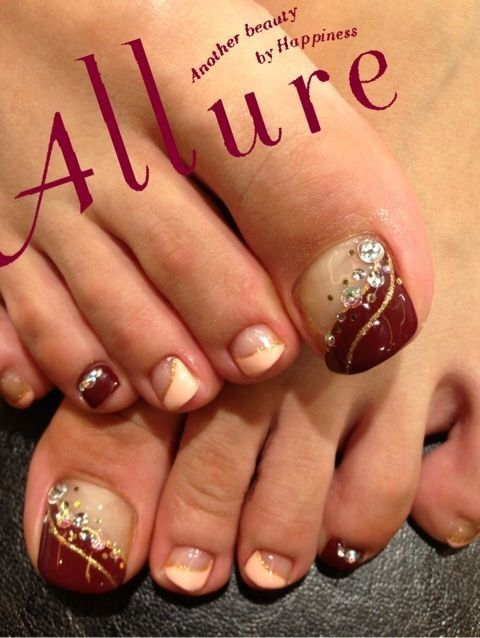 Burgundy and peach toenails with accent rhinestones