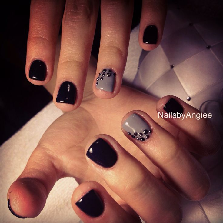 Super short nail design with black and gray gel colors with Swarovski black diamonds..