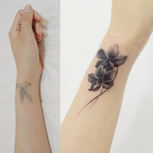 Flower wrist cover up tattoo - It's much easier to cover tattoos that are faded away by time and have less shades in them; like this one. From a faded bird to simple and yet beautiful design, it would even be safe to say it's the only tattoo there.