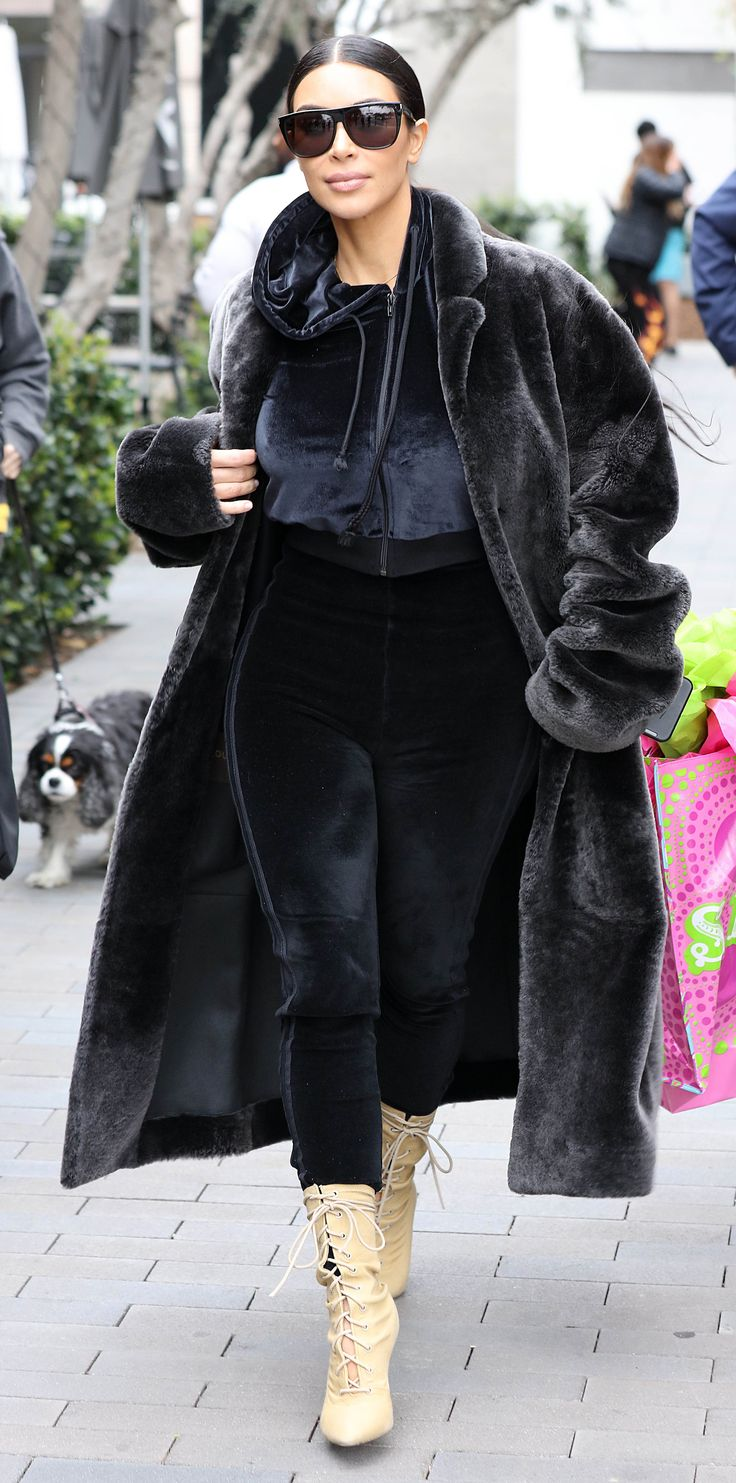 The mom-of-two stepped out in a full-on velvet tracksuit (get a pair of velvet joggers from Topshop), complete with a long plush coat and cream, lace-up booties.