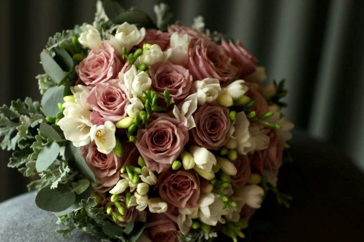 Brides bouquet of roses freesias and blue gum