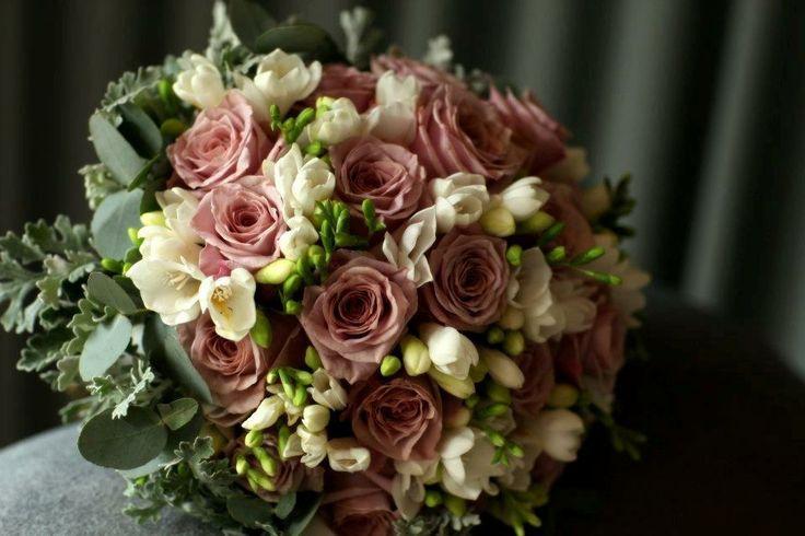 Brides bouquet of roses freesias and blue gum