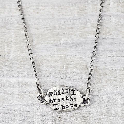 """A petite necklace that reads """" while I breathe I hope"""" on the front with a butterfly on the back. Shop more of our inspirational handmade jewelry>>www.islandcowgirl.com"""