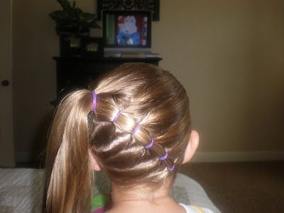 Angela: If B will stay still long enough, here is a site with ALOT of hairstyles for little girls.