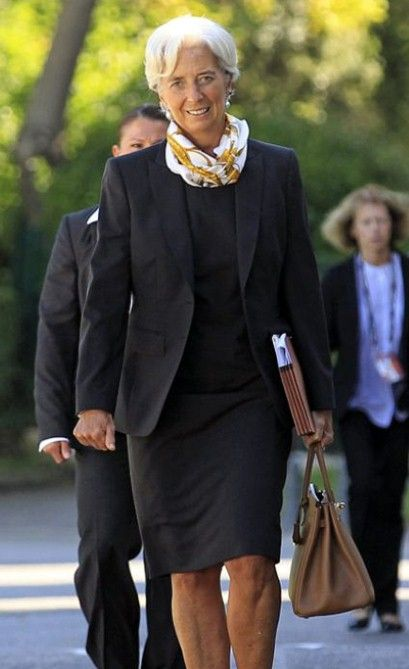 But the prize for the most virtuosic deployment of the work uniform today goes to Christine Lagarde, the French lawyer who runs the International Monetary Fund. Her tailored dark (black or charcoal) suits are accessorized with a great haircut, dangling pearl earrings, and an Hermès scarf. That's it. She's nearly 60 and succeeds in looking both female and powerful without seeming to overthink either. Never has so little looked like so much.