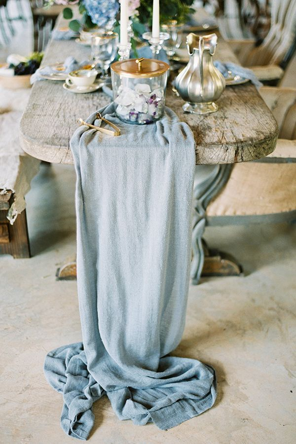 Dreamy French Inspired Wedding Details in blue silk; rustic wedding ceremony with candles and flowers