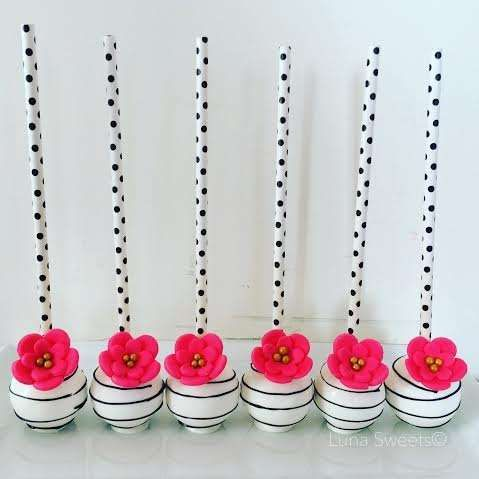 Floral cake pops at a Kate Spade bridal shower party! See more party planning ideas at CatchMyParty.com!