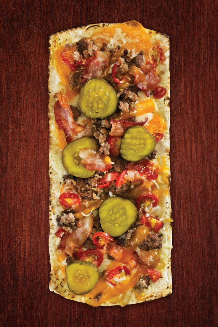 1 Flatout® Flatbread Artisan Thin Pizza Crust 1/2 cooked ground beef, cooked 2 Tbsp. ketchup 1 small tomato, cut in medium pieces 3 Tbsp. cooked bacon pieces 1/2 cup shredded mozzarella/Cheddar blend cheese 6 slices sweet pickles Place flatbread on a cookie sheet. Bake at 375 degrees for two minutes. Remove from oven. Top flatbread Continue Reading...