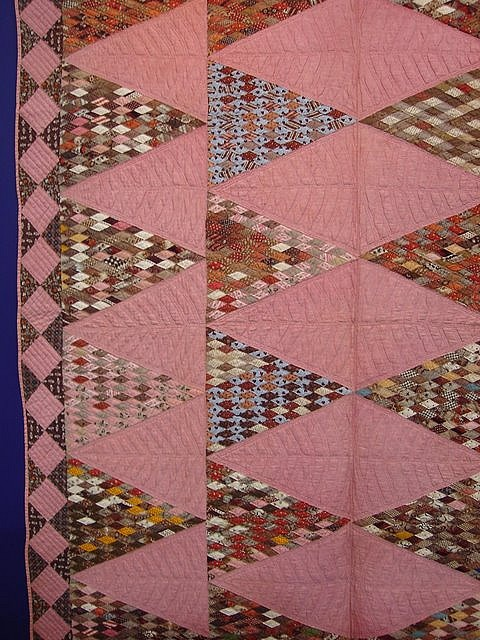 A super-scrappy Sugar Loaf Quilt with teeny diamonds.