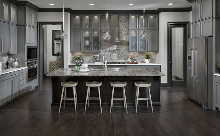This Gourmet Kitchen Features A Center Island With Seating