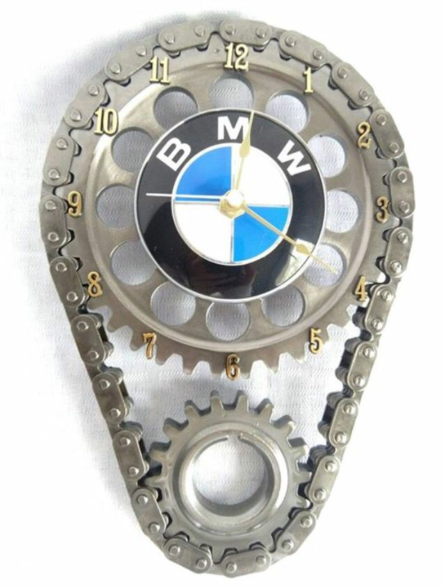 The BMW emblem is a super classy look atop the elegant bare metal finish of the gear set. There are several stages to building a gear clock. Obtaining, cleaning, welding, cleaning again, polishing, clearing, drying and assembling. All used engine components are thoroughly cleaned with industrial solvents... more at http://www.carfurniture.com/products/bmw-engine-timing-gear-and-chain-wall-clock