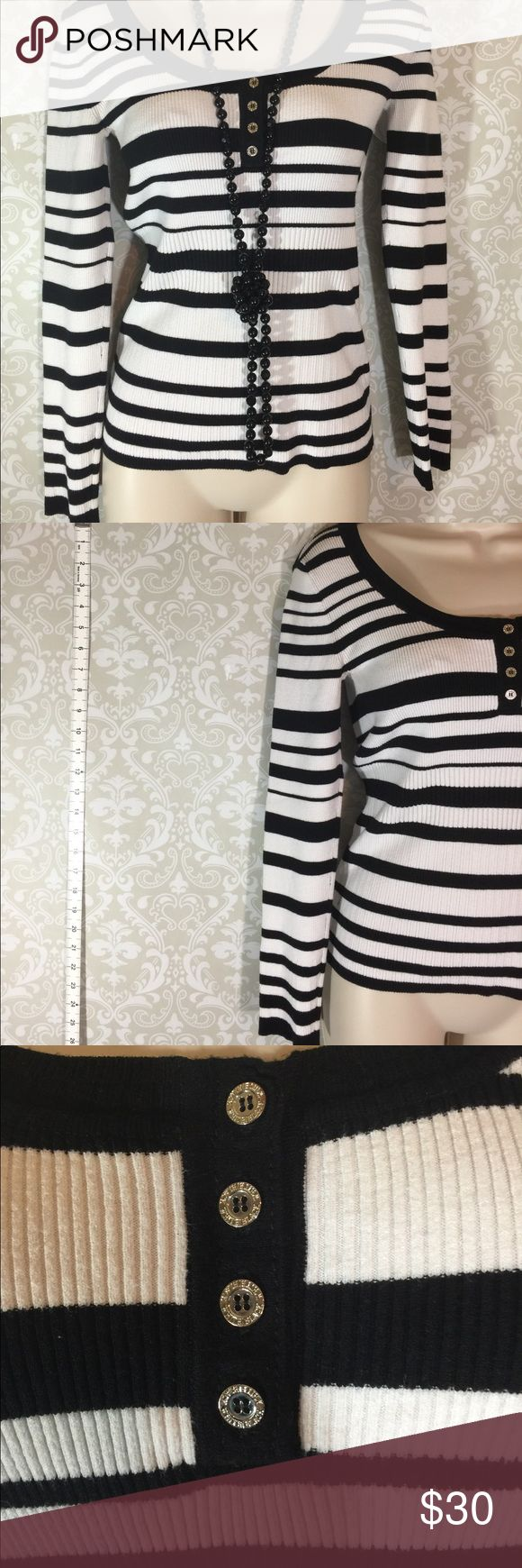 White House Black Market Sweater Super cute WHBM light weight black and white stripped sweater.  Size M.  Previously worn, cared for and loved.  Excellent condition. Please ask any question you might have.  Reasonable offers welcome.  Bundle for savings.  Thank you for shopping in my closet! White House Black Market Sweaters Crew & Scoop Necks