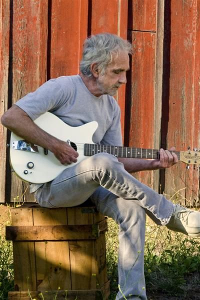 J.J. Cale with Danelectro convertible.