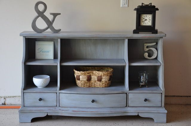 using dark wax to age a piece of painted furniture-apply wax, buff off, and use steel wool to blend it: Awesome Tv, Aged Bookcase, Bookshelves, Dark Wax, Bookcase Aged, Dresser Turned Into Tv Stand, Aged Bookshelf, Dresser Turned Tv Stand