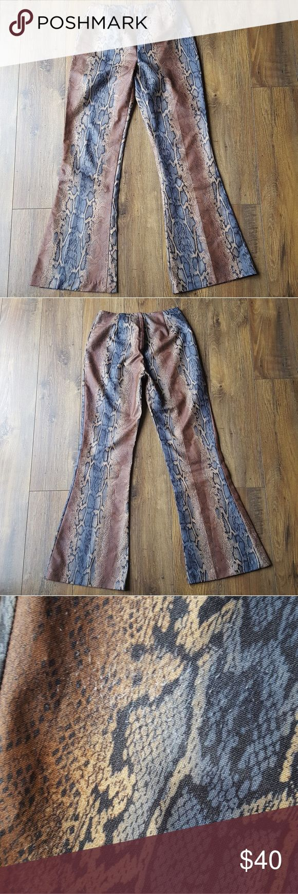 AMAZING snakeskin print flare pants! Late 90's feels right here.  Awesome flare and a mid-high rise waist.  Zipper on the side to close.  These are in great shape, there's just one little spot on one of the hips where the fabric is slightly fuzzy, as pictured.  But with the print, it's almost invisible!  Bundle discount.  I love offers:) Right now I'm having a buy 1 get 2 free sale!  So go ahead and check out the rest of my closet and make a bundle of at least 3 items to take advantage of my…