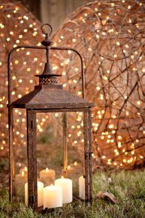 rusty lantern with illuminated vine spheres