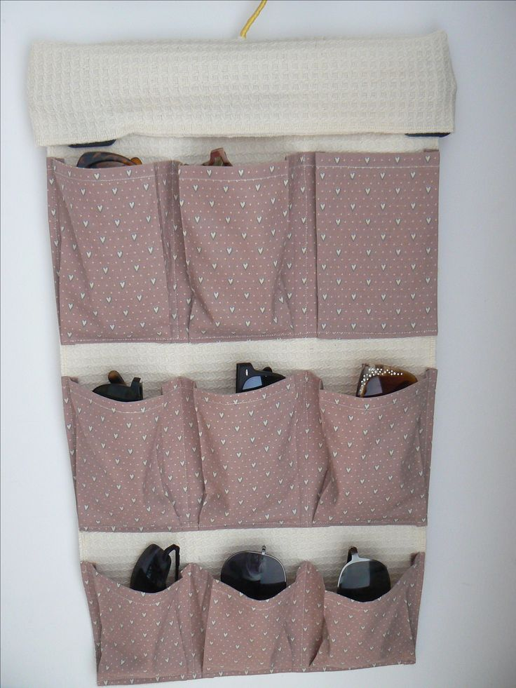 """I used a trouser hanger for the organiser and decided to cover it with a small pocket 15"""" x 7.5"""", folded in half."""