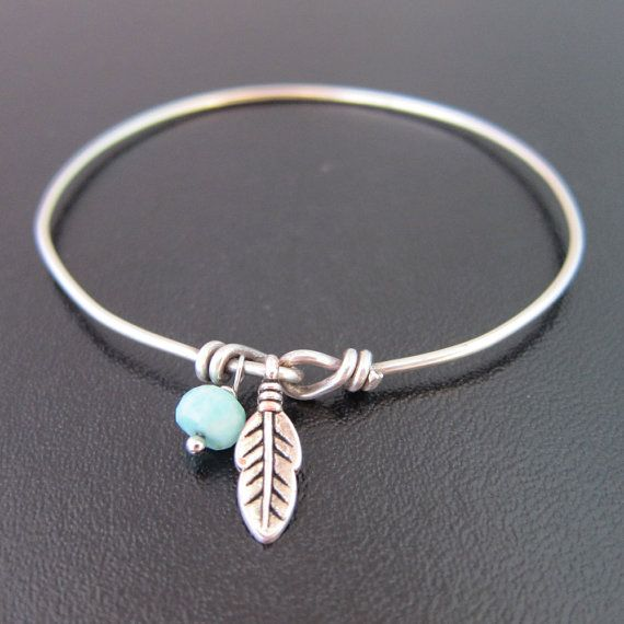 A small silver tone feather charm and a seafoam chrysoprase faceted rondelle bead are dangling from this hand formed double loop bracelet in silver