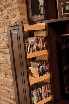 Exactly what I've been trying to talk my husband into doing (building a custom entertainment center). These shelves would be perfect for keeping movies organized but out of sight