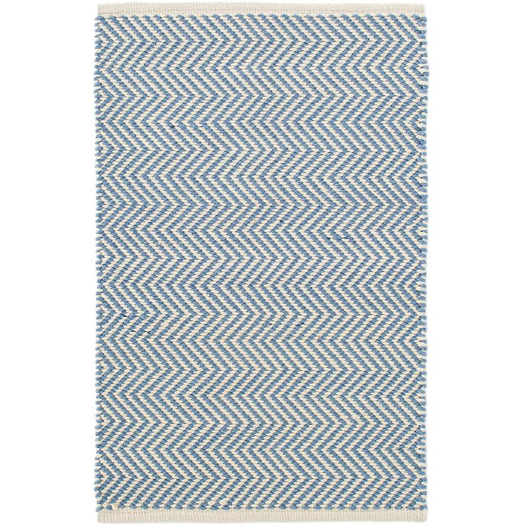 "Youll say ""Oui, oui!"" to this indoor/outdoor rug featuring a country-cool French blue and ivory zigzag pattern. Made of durable, easy-care PET, its the perfect floor covering for the kitchen, hallway, bedroom, or porch.Made of 100% PET, a polyester fiber made from recycled plastic bottles.In order to achieve its rustic charm, this rug has been woven with large-diameter yarns. Consequently, slubs, knots, and other imperfections inherent to the hand-weaving process may be more visibl..."