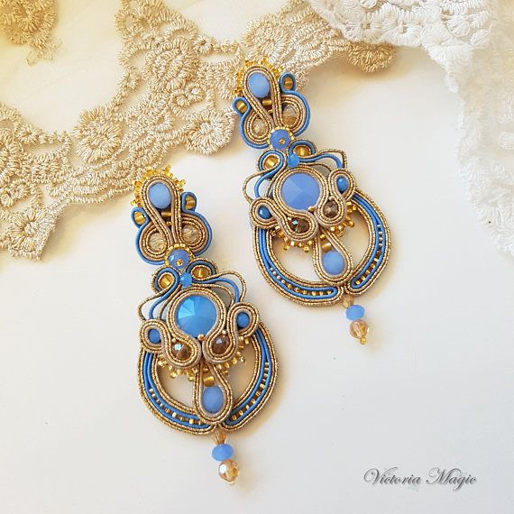 Check out this item in my Etsy shop https://www.etsy.com/ru/listing/513564014/soutache-earrings-3-in-1-long-gold-blue