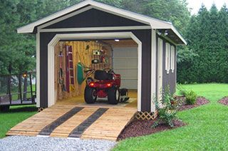 Storage buildings garage and lawn mower on pinterest for Lawn mower storage shed