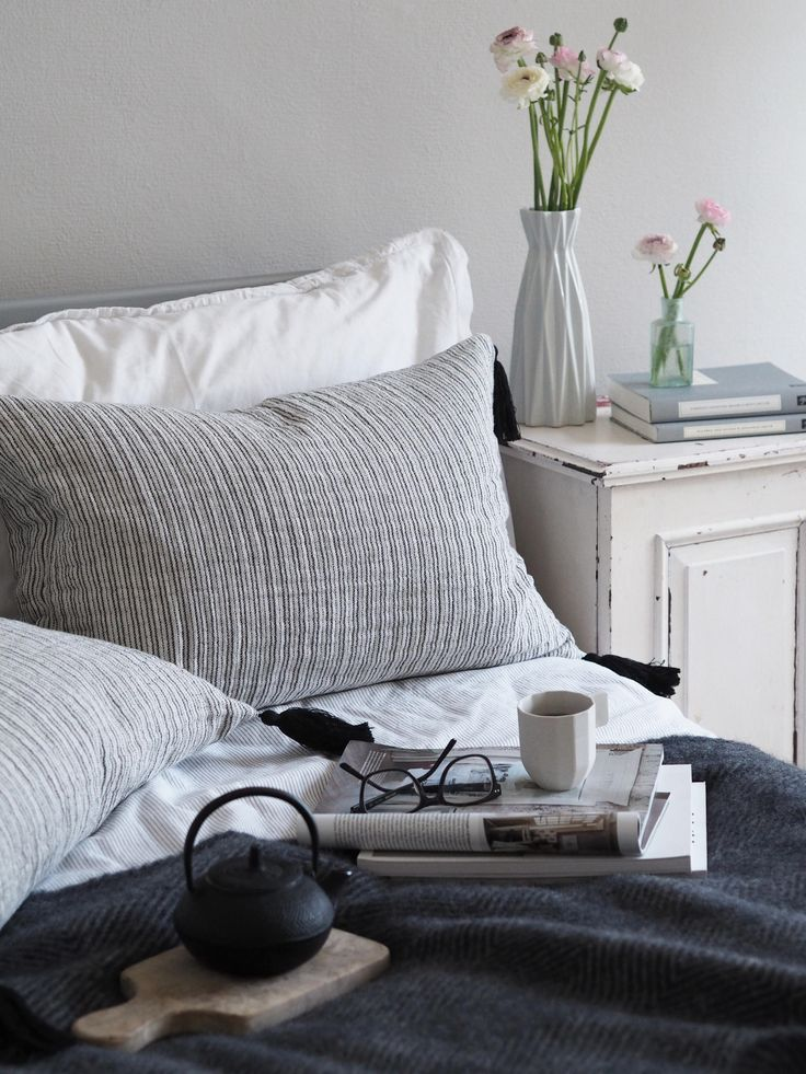 A cosy bedroom corner, with lots of textures, mixing old and new